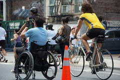 Bicyclists and a guy in wheelchair riding on Lafayette Street during Summer Streets. (jackszwergoldarchives) Tags: manhattan newyorkcity summerstreets szwergold