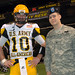 Spec. David Hutchinson of the Army Reserve stands with Connor Wood from Second Baptist High School in Houston, before the start of the U.S. Army All American Bowl game at the Alamodome here Jan. 9.