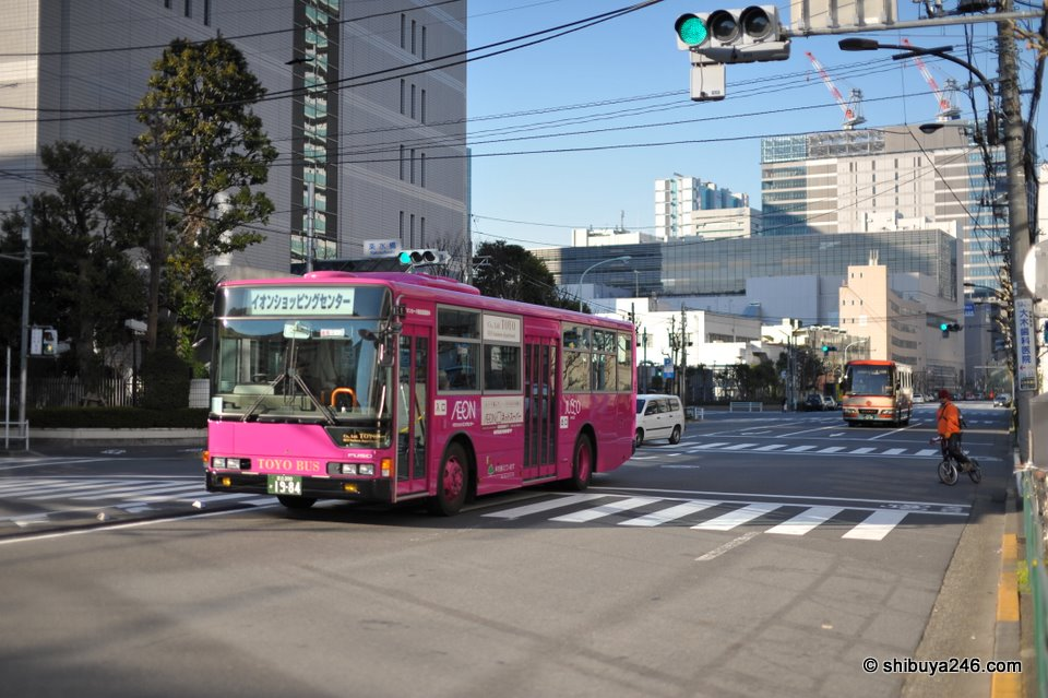 Bright pink bus taking people to the Aeon Jusco store at Shinagawa Seaside.