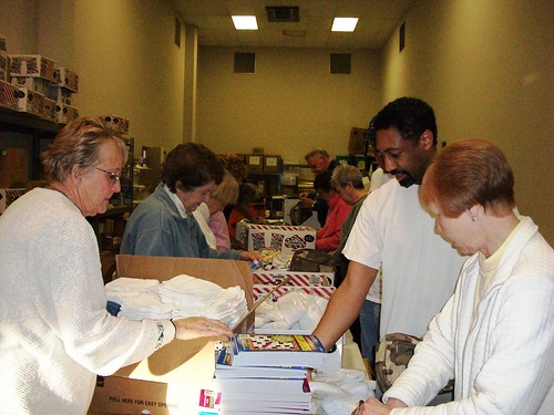 Volunteers help package gifts to be sent to troops overseas through Operation Compassion.