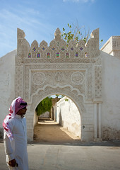 Farasan island - Saudi Arabia (Eric Lafforgue) Tags: door portrait house man coral vertical architecture outside outdoors island outdoor redsea decoration ile gateway ottoman habitat maison saudiarabia humanbeing turkish oneperson homme farsan ksa merrouge jazan farasan tiama saudiarabien gizan stuc exterieur coralstone turc tihama colorpicture arabiasaudita kingdomofsaudiarabia   photocouleur  arabiesaoudite jizan  farasanislands  suudiarabistan arabsaudi  etrehumain colourpicture  ottomanturks saoediarabi arabiasaudyjska farazan    ksa9087  farazanislands jizaan juzurfarasan