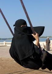 Having fun in Jeddah - Saudi Arabia (Eric Lafforgue) Tags: game girl fun veiled arabia voile saudiarabia ksa balancoire saudiarabien arabie  arabiasaudita kingdomofsaudiarabia   arabiesaoudite    suudiarabistan arabsaudi  voileislamique  saoediarabi arabiasaudyjska    ksa2715