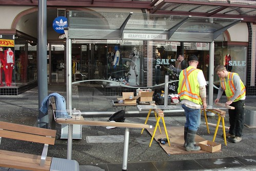 City crews put together new street furniture on Granville Street