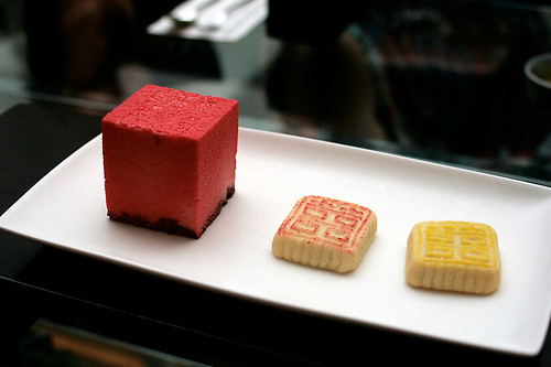 East meets West desserts - raspberry chocolate mousse and two pastries with red bean and lotus paste within