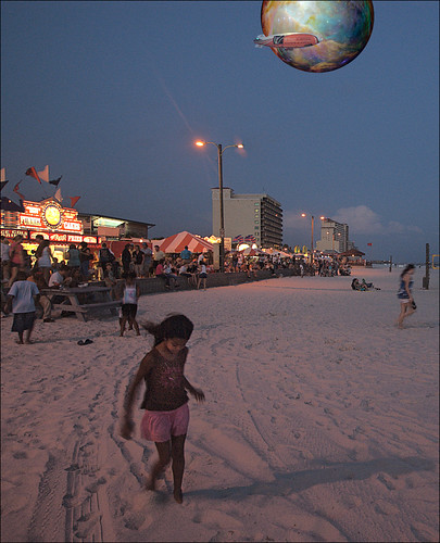 the dragging of young feet through the warmth of the evening sand, magical