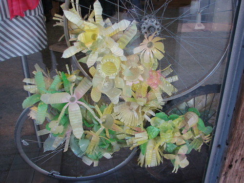 The window display at Anthropologie was made with plastic bottles cut and painted to look like flowers
