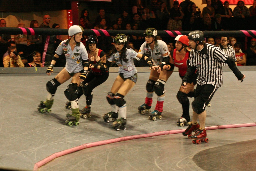 Punk rock roller derby girls skating at the Doll Factory downtown Los Angeless