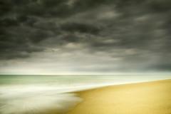 Solitude (Alfredo11) Tags: sea sky naturaleza seascape beach nature water clouds mar sand agua nikon waves playa paisaje arena cielo nubes olas nikond3