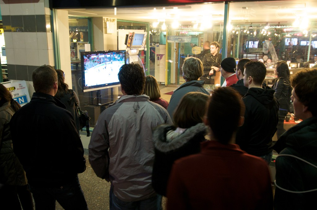 People Gathered Around to Watch Team Canada vs Norway