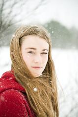 valavala (júlía ∆) Tags: red snow girl hair snowflakes 50mm movement nikon pretty wind bokeh coat f18 tones icelandic vala d90 valgerður