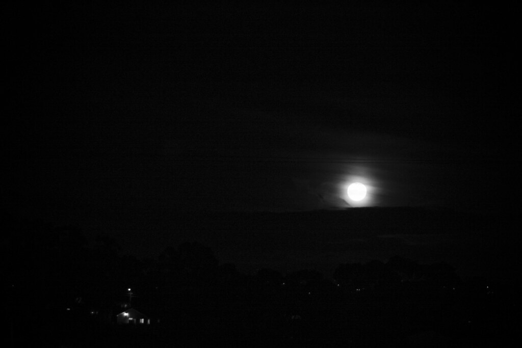 full moon rising b&w