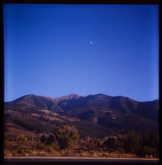 Mountains and moon (yarnzombie) Tags: park camera moon mountain 120 6x6 film mediumformat square diy saturated sand colorado kodak dunes great slide national expired ektachrome e6 rapid 2009 develop genos arista e100s