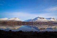 In Reyðarfjörður today (*Jonina*) Tags: winter sea sky mountains reflection iceland village ísland vetur himinn hafið speglun fjöll coth reyðarfjörður reydarfjordur þorp distinguishedpictures absolutelystunningscapes
