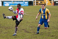Woking v Basingstoke Town (Chris Turner Photography) Tags: uk blue playing game rain square daylight town football woking day play ryan stadium soccer south overcast surrey gb match conference non fc stephens ricky league basingstoke kingfield anane