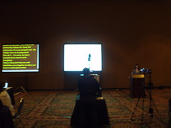 CSUN Tweetup - two screens, one for live transcription and one for presenter's slides