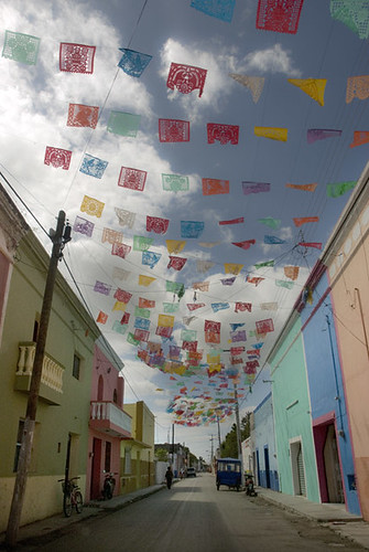 Prayer flags on colorful street in a village in Yucatan, Mexico