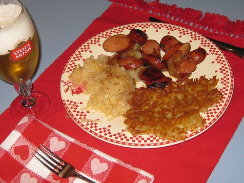 Polish Kielbasa with Caramelized Onions, Sauerkraut and Crispy Potato Pancakes