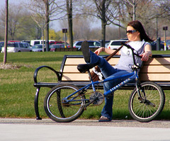 Sit and Snap Pic (FrogBum) Tags: woman girl sunglasses bike bicycle spring michigan candid leg harrisontownship metroparks eightpack huronclintonmetroparks harrisontwp huronclinton metrobeachpark
