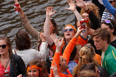 Koninginnedag 2010 - People partying on boat in canal Amsterdam (Fabi Fliervoet) Tags: birthday family party orange holiday holland beer dutch amsterdam 30 festive boats togetherness singing dancing market unity stock thenetherlands royal parties canals queen celebration national april concerts juliana craze festivities crowds shouting 2010 queensday koninginnedag nationalholiday wilhelmina freemarket april30 april30th koningin wilhemina fabifliervoet