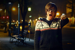I HAVE THE REMOTE! (Lance Szydzik) Tags: lighting christmas street city boy red portrait urban cute nerd tattoo night self canon lens 50mm prime glasses ginger hoodie sweater dof natural time bokeh head ring freckles 18 piercings 34 gauges septum snakebites t1i