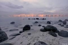 Dreamy beach of Punggol. (Reggie Wan) Tags: sunset seascape beach singapore rocks asia southeastasia punggol rockybeach sonya700 sonyalpha700 reggiewan