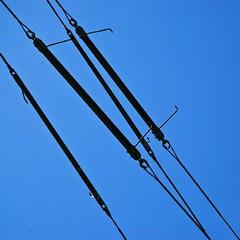 spark-gaps (HUNGRYGH0ST) Tags: blue 2 two sky black color colour electric four high support suspension 4 gap utility pole pylon diagonal electricity tension spark caple