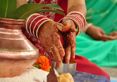 Abundance (Shrimaitreya) Tags: wedding india love feet hands rice indian religion offering maharashtra hindu puja shubh bangles vivaha anuradha brahmin mangalam earthasia pleaseremembertotagyourphotoearthasia