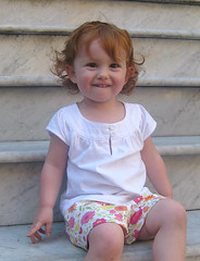 Speck, sitting on some city steps in colorfun shorts