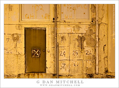 Yellow Wall with Door and Numbers (G Dan Mitchell) Tags: sanfrancisco california door old light urban usa building abandoned window lamp stain yellow metal wall night yard concrete island photography bay rust paint industrial mare ship decay stock pipe structure historic number worn area letter northamerica naval vallejo distressed sodium vapor conduit dilapidated nocturnes minsy induro