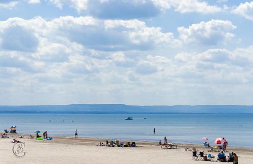 Wasaga Beach; a nearly empty beach stretches for miles with blue sky and water contrasting with the almost white sand