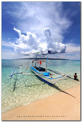 Banca (solidskorpion) Tags: ocean boy sky sun beach water clouds island boat sand philippines wideangle shore boracay 1022mm banca  pukabeach