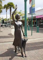Art Deco Napier (russelljsmith) Tags: city trees newzealand vacation sculpture woman dog holiday art history girl statue architecture bronze shopping fun town community tour open outdoor wide sunny center tropical shops artdeco napier spaces hawkesbay 2010 uplifting efs1855mmf3556is
