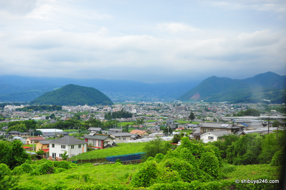 Getting closer to Kofu there are lots of mountains. Kofu is surrounded by mountain ranges and is like a bonchi, very similar to Kyoto, meaning in winter it is quite cold but in summer can be very humid.