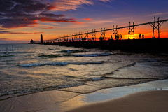 Grand Haven lighthouse silhouttee (Michigan Nut) Tags: longexposure sunset wallpaper orange beach water silhouette reflections geotagged pier nikon waves lakemichigan lakeshore 70300mm sunsetreflection cloudformation michiganlighthouses grandhavenmichigan grandhavenlighthouse sunsetsilhouette absolutemichigan lakemichigansunset freewallpaper d700 sunsetwallpaper lakemichiganlandscape michiganlandscapes capturenx2 reversendfilter ringexcellence dblringexcellence tplringexcellence lighthousewallpaper