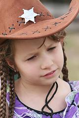 New Sheriff In Town (wyojones) Tags: cute girl look hat hair pretty texas dress greeneyes hazeleyes sheriff braids brunette cowboyhat braidedhair cowgirlhat rosenburg georgeranch sheriffbadge georgeranchhistoricalpark wyojones texianmarketdays