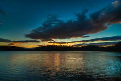 10-29-2010 Sunset (pennuja) Tags: sunset sky sun lake reflection water colors set clouds nikon october photomatix d700