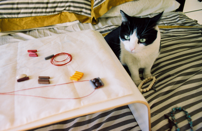making necklaces with my assistant