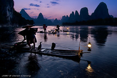 Cormorant Fishing Blues (DanielKHC) Tags: china mountain 3 mountains digital river landscape li interestingness high fisherman nikon dynamic dusk traditional scenic bamboo hills explore cormorant raft lantern karst range dri hdr blending  guanxi d300 xingping  danielcheong danielkhc tokina1116mmf28 visipix