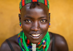 Portrait of a beautiful smiling Hamer tribe woman, Omo valley, Dimeka, Ethiopia (Eric Lafforgue) Tags: adult africa beads beautiful beauty blackpeople closeup colorful culture developingcountry dimeka eastafrica ethiopia ethiopia0617320 ethiopian ethiopianethnicity female haircut hairstyle hamar hamer headshot headwear horizontal hornofafrica indigenousculture jewel jewelry lookingatcamera multicoloured necklaces omovalley onepersononly onewomanonly portrait smiling southernethiopia traditionalclothing tribal tribe tribeswoman truepeople turmi women yellowbackground et