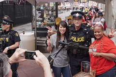 No pointing guns. Feel free to shoot. (beyondhue) Tags: opp officer ottawa canada day 150 celebration people crowd gun beyondhue exit sparks street pose photo taking uniform police