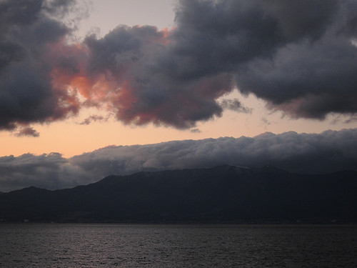 Clouds, mountains and lake at dusk