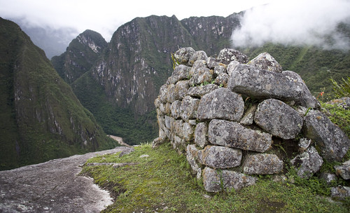 Rocks not yet 'restored' overlook the Urubamba Valley on Machu Picchu's lower eastern terraces.