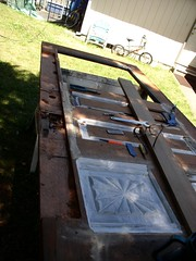 Door Restoration in Process (Imagination Unincorporated) Tags: cedardoor doorrepair antiquedoor doorrestoration redwooddoor queenanndoor doormodification