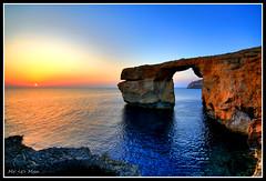 Setting on Azure (Mr <e> Man) Tags: blue sunset window water rock canon eos high arch dynamic azure sigma malta range hdr gozo 450d