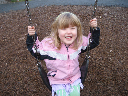 Smiling on the swing