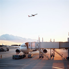 (ricky nyhoff) Tags: travel sunset japan plane t nc airport kodak air flight hasselblad carl worker 28 takeoff portra runway cf narita planar 160 80mm 500cm konichiwa ziess
