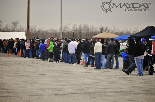 Check out the crowd lining up to watch the cars