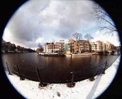 Zwanenburgwal (wisze) Tags: city snow amsterdam sneeuw slide dia canals fisheye  grachten stad onehundredandeighty peleng fujivelvia100 olympusom2n zwanenburgwal