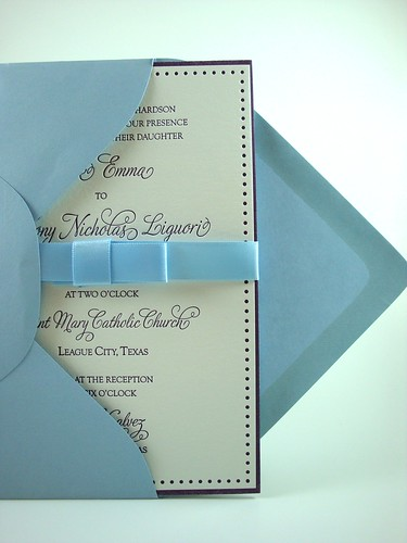 Using buckle bows as the belly bands for our wedding invitations turned out
