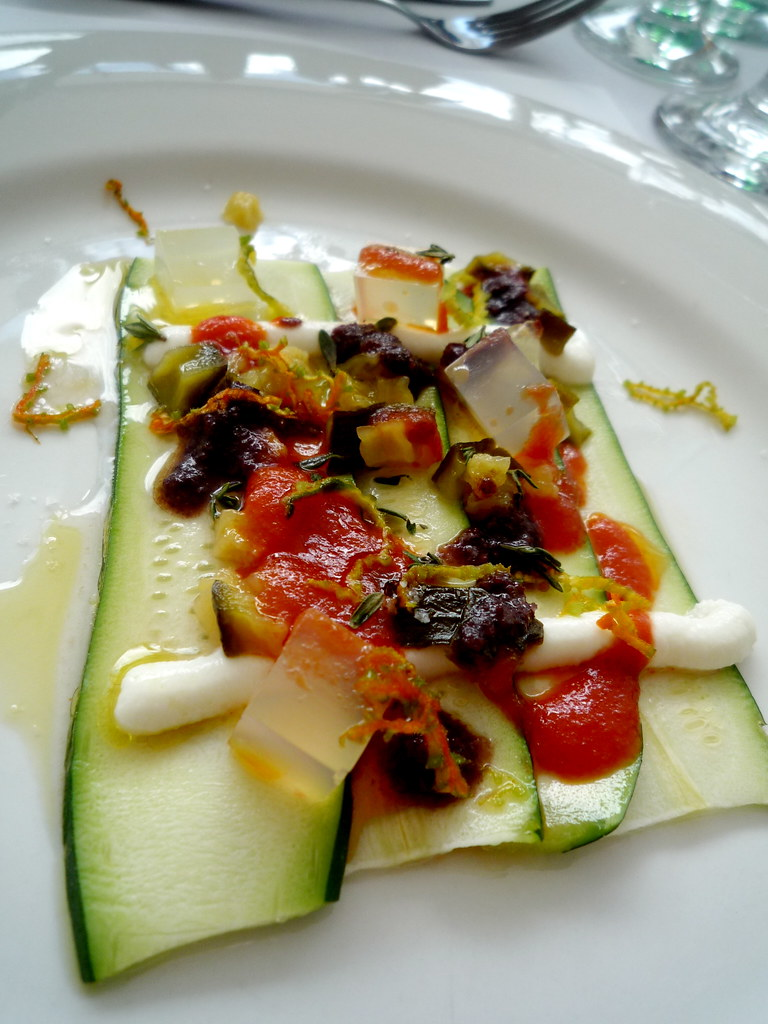 Raw zucchini, goats curd, zucchini confiture, paremesan gel, olive and tomato sauces, thyme